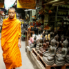 Monks walking in Bangkok amulet market - Laetitia Botrel | Photography