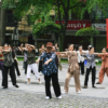 Morning gymnastics in Hanoi's street, Vietnam - Laetitia Botrel | Photography
